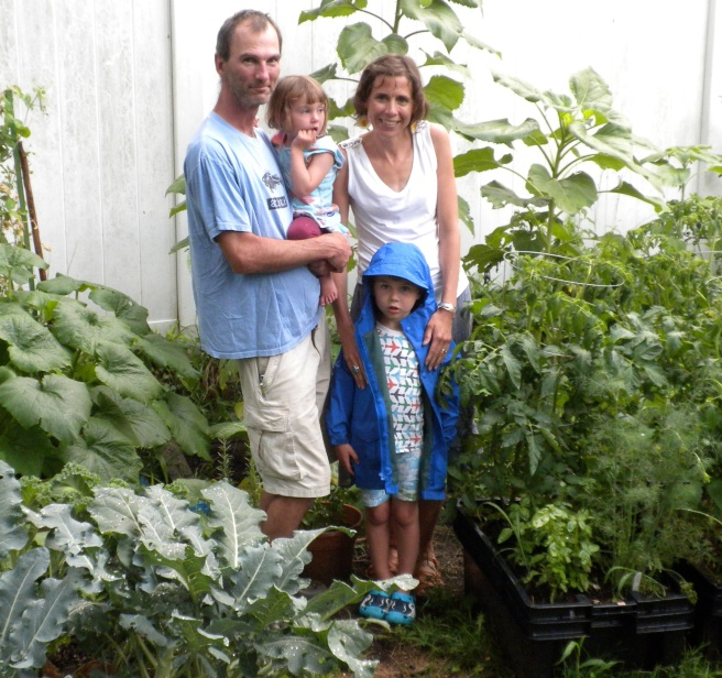 Peggy and her family in their garden.JPG