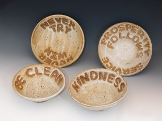 """Dogtown Bowls"" by Nina Goodick. They are high fired stoneware, 6"" diameter by 2"" high."